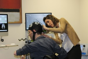 Spinal cord injury patient Francesco Clark (left) takes part in spinal cord injury rehabilitation research at Burke. Here he is being prepared for non-invasive brain stimulation by Burke's Mar Cortes, M.D. (right). Clark is among those advocating for SCIRP to be fully reinstated.